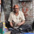 Tailoring and shoe repair shop on a street in North India — Stock Photo #11432833
