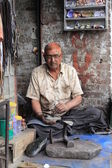 Tailoring and shoe repair shop on a street in North India — Stock Photo