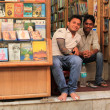 Two young men sellers of music CDs — Foto Stock