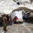 Stock Photo: Glacial arch in Himalayas.Group photo of Indifamily