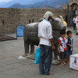 Stock Photo: Children are photographed near sacred cow.Temple of Shiv(Gauri-Shankara) in Naggar