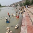 Daily ablutions (of bathing) in the Ganges - Stock Photo