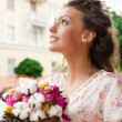 Young woman with bouquet - Stock Photo