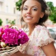 Woman with bouquet — Stock Photo #11472300