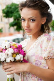 Woman with bouquet — Stock Photo