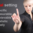 Goal setting concept - business woman touching screen - Stockfoto