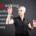 Goal setting concept - business woman touching screen — Stock Photo #11848762