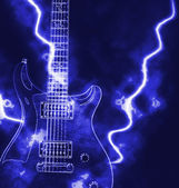 Electric guitar and ray of light — Stock Photo