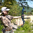 Young archer training with the bow — Foto de Stock
