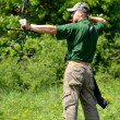 Modern bow hunter in the woods — Foto Stock