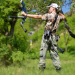 Young archer training with bow — Stock Photo #10757162
