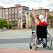 Woman in wheelchair - Stock Photo