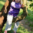 Little girl on the tree — Stock Photo