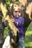 Little girl on the tree — Stock Photo