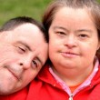 Down syndrome love couple — Stock Photo #10951104