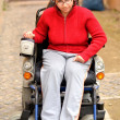 Young invalid woman on the wheelchair - Stockfoto