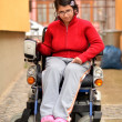 Young invalid woman on the wheelchair - Stock Photo