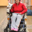 Young invalid woman on the wheelchair — Stock Photo