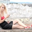 Young beautiful blond woman with cellphone — Stock Photo
