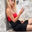 Young beautiful blond woman with cellphone — Stock Photo #11270898