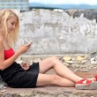 Young beautiful blond woman with cellphone — Stock Photo #11270921