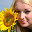 Blonde with sunflower — Stock Photo
