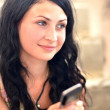 Young beautiful woman with cellphone — Stock Photo