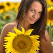 Portrait of young woman with sunflowers - Stock Photo