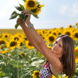 Portrait of young woman with sunflowers — Stock Photo #11658198