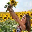 Portrait of young woman with sunflowers — Stock Photo