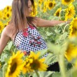 Portrait of young woman with sunflowers — Stock Photo #11658325