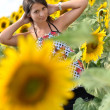 Portrait of young woman with sunflowers — Stock Photo #11658329