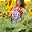 Portrait of young woman with sunflowers — Stock Photo #11658451