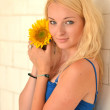 Blonde with sunflower — Stock Photo #11679037