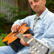 Guitarist playing guitar — Stock Photo