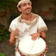 Stock Photo: Mplaying djembe