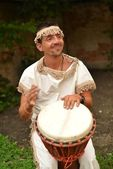 Man playing the djembe — Stock Photo