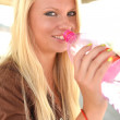 Portrait of young woman drinking water — Stock Photo #12149077