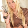 Sexy Blonde with a gun — Foto Stock