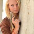 Sexy Blonde with a gun — Stock Photo #12176921