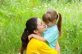 Smiling young mother has good time with daughter — Stock Photo
