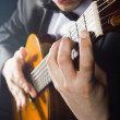 Playing the guitar — Stockfoto