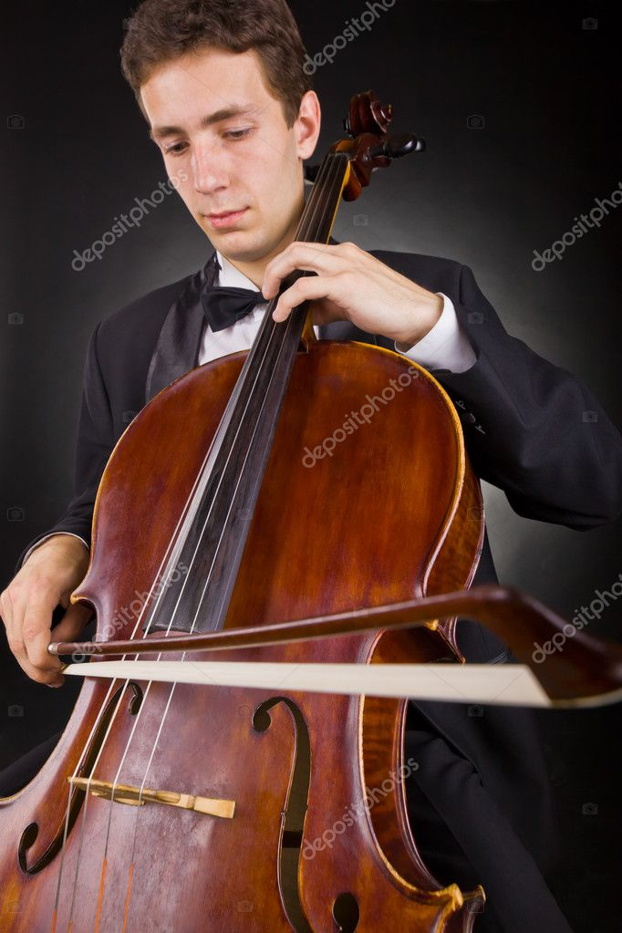 Cellist playing classical music on cello on black background. Focus on the cello — Stock Photo #11039182