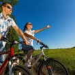Happy couple on bikes - Stock Photo