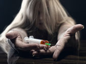 Young woman with a drug — Stock Photo