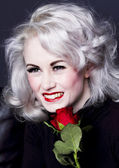 Happy woman with red rose — Stock Photo