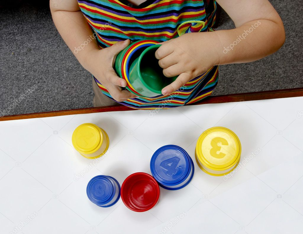 Baby playing with plastic cups educational — Stock Photo #11145810