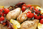 Baked chicken lemon and tomatoes — Stock Photo