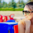 Portrait of young woman with sunglasses — Stock Photo #11344396