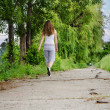 Young woman jogging alongside — Stock Photo